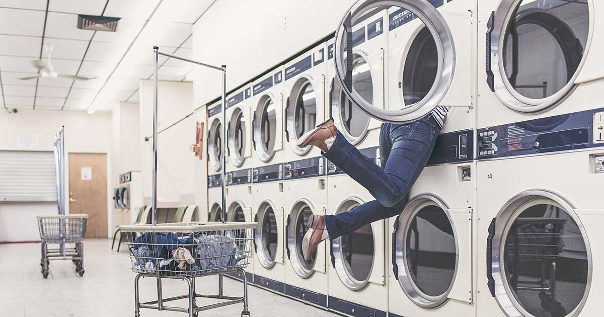 woman hanging out of washing machine