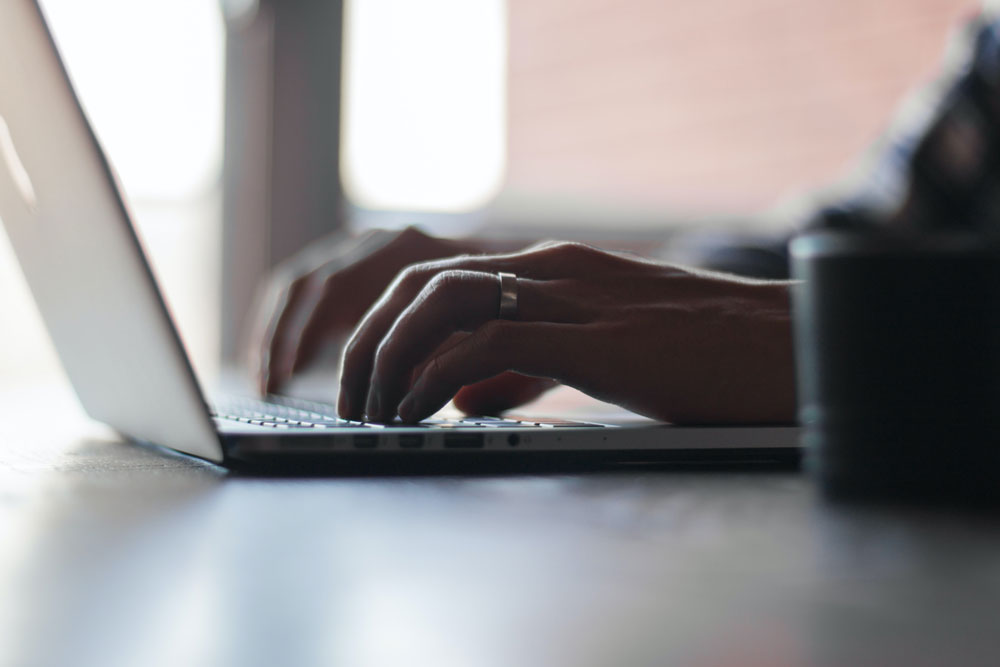 closeup of typing on laptop taking voc survey