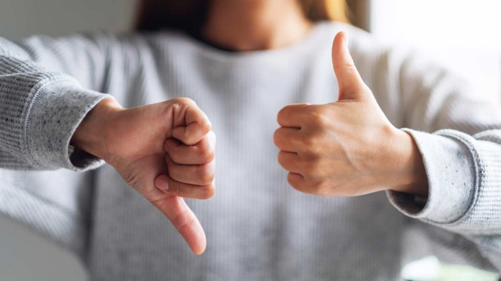 Person showing thumbs up and thumbs down