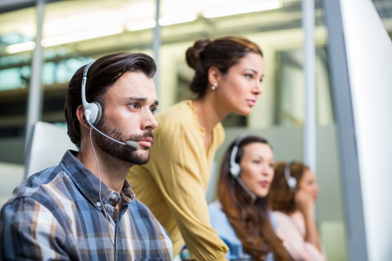 agents working in call center to solve customer service challenges