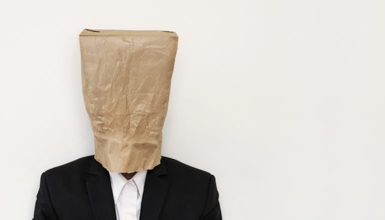 person wearing brown paper bag on head