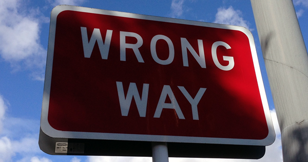 wrong way sign showing how companies get knowledge management and knowledge centered support wrong