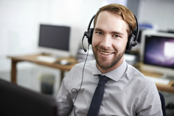 Customer service rep smiling on the phone demonstrates call center best practices
