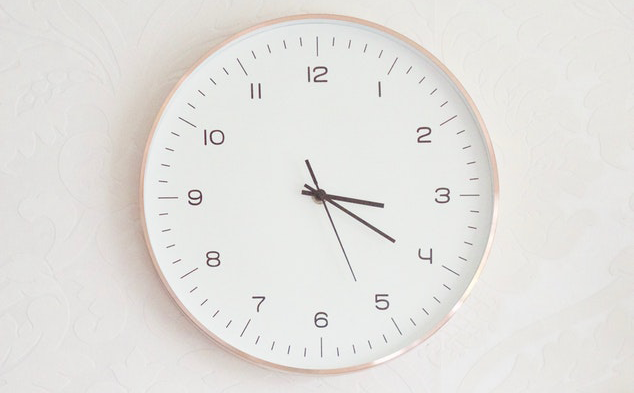 modern clock on a wall symbolizing average handle time in the call center
