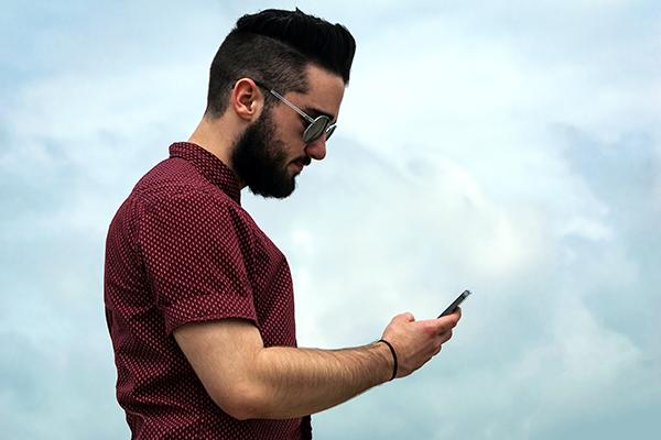 man using smartphone for cloud customer data