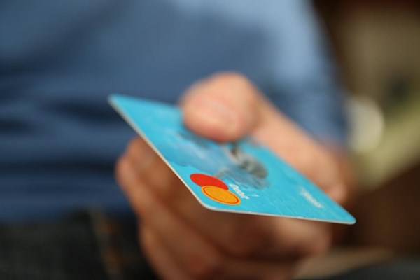 person holding credit card