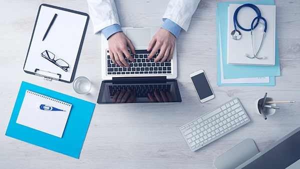 medical professionals using technology for healthcare customer experience