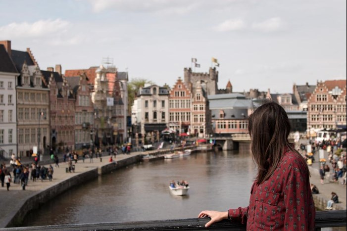 woman looking out over bridge in Europe pondering EU Privacy Shield and EU consumer privacy regulations