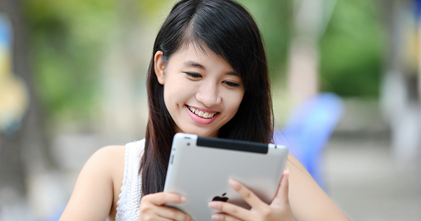 smiling woman using a tablet