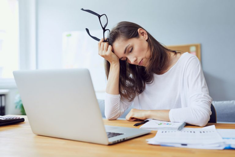 businesswoman at desk worried social media strategy is falling behind