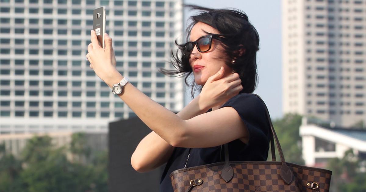 social influencer taking a selfie