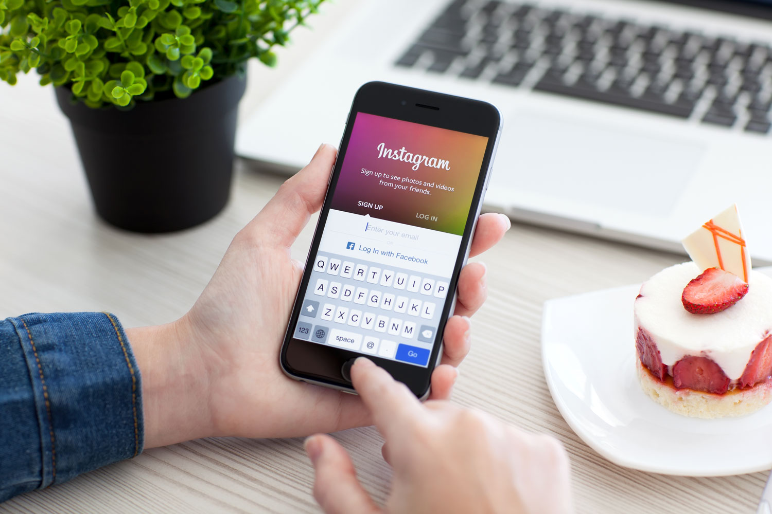 Instagram being used in front of a keyboard for social media marketing