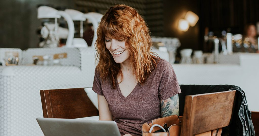 woman reading online reviews on laptop