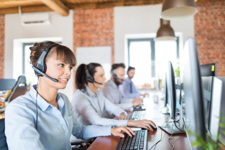 happy agents working in modern call center