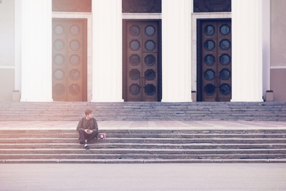 man sitting on steps expecting personalized customer experience