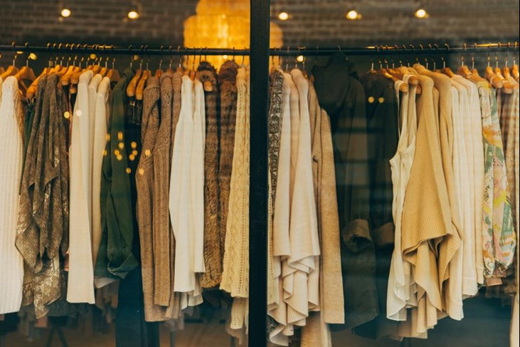 clothes hanging in a retail shop