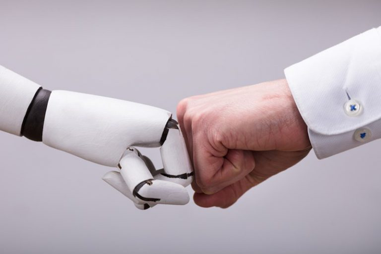 robot and human fistbump
