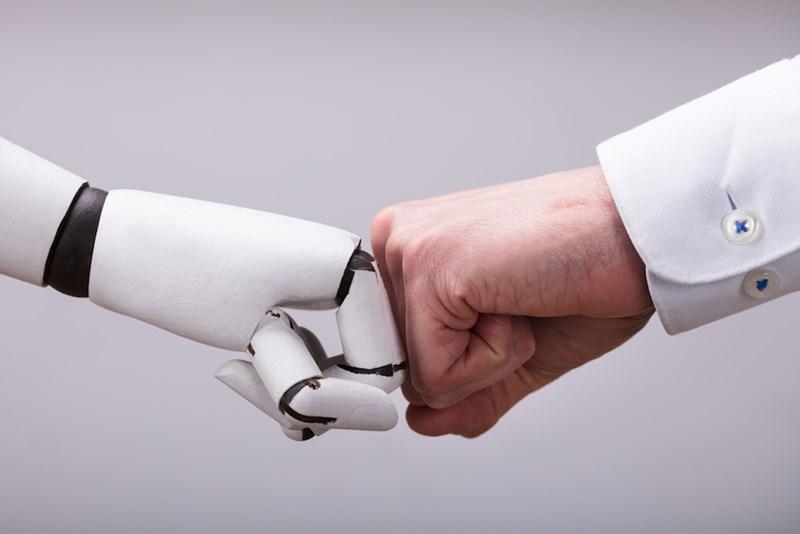 robot and human fistbump