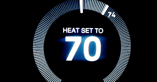 smart thermostat representing customer service trends like IoT