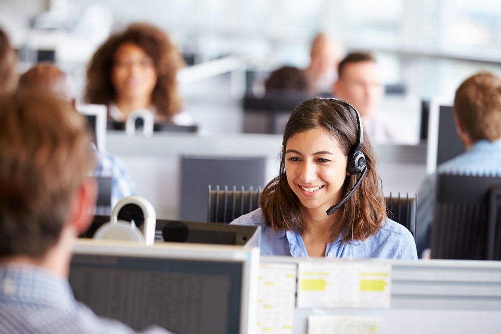 agents working in contact center using specialized crm software for customer service
