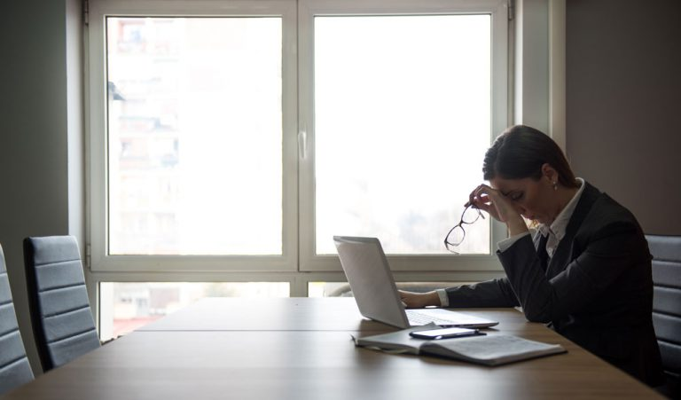 woman looking frustrated by knowledge management system kms pitfalls