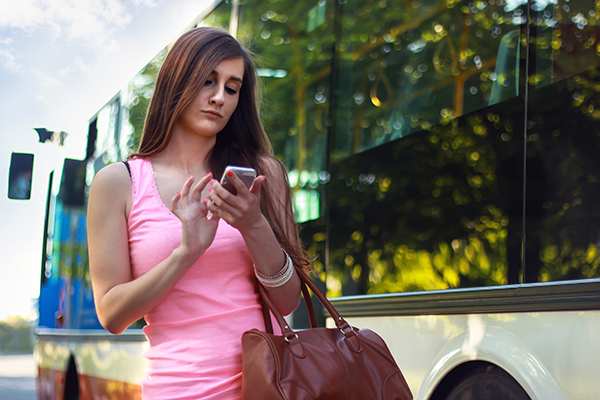 Woman with smartphone using Mobile Channels for Customer Service