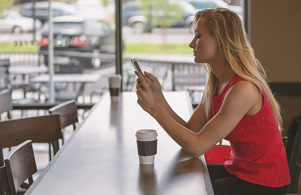 Woman using smartphone for Live Chat for Customer Service