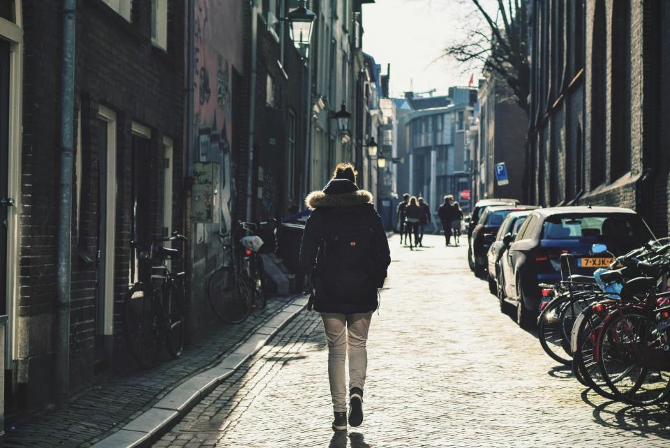 customer churning walking away down a street