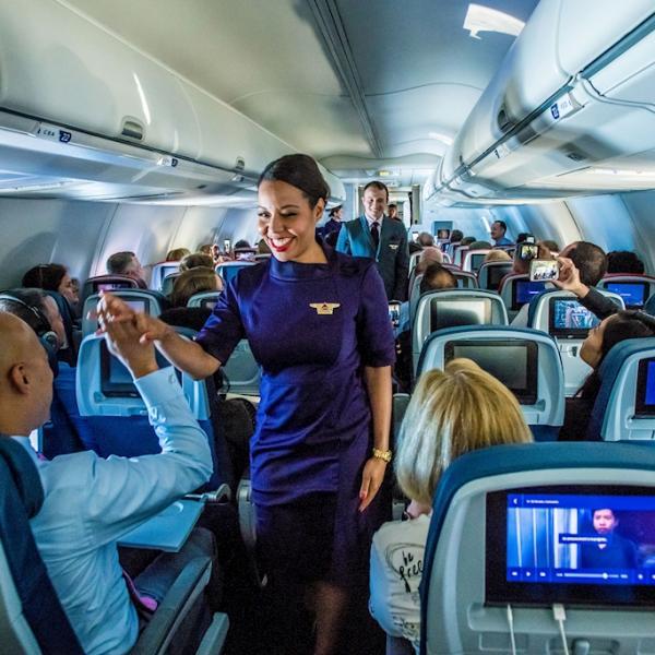 delta flight attendant in aisle