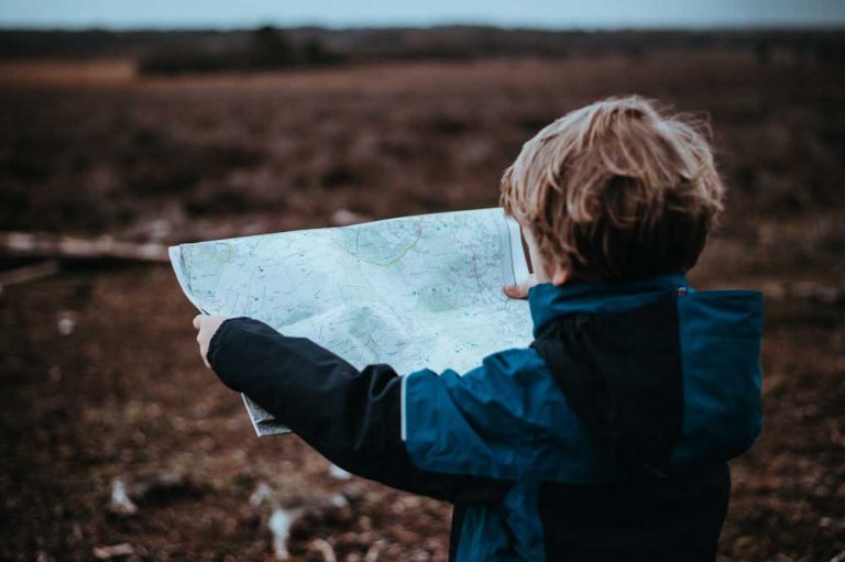 kid holding a map