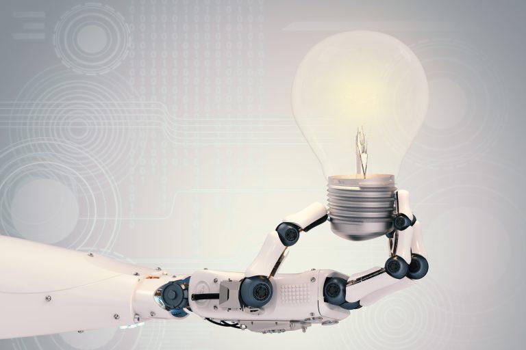 robot hand holding lightbulb