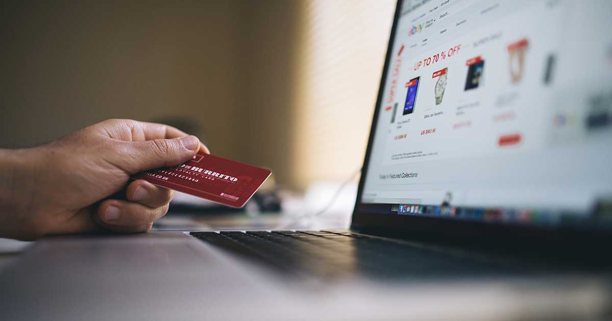 person using loyalty card to shop online ecommerce