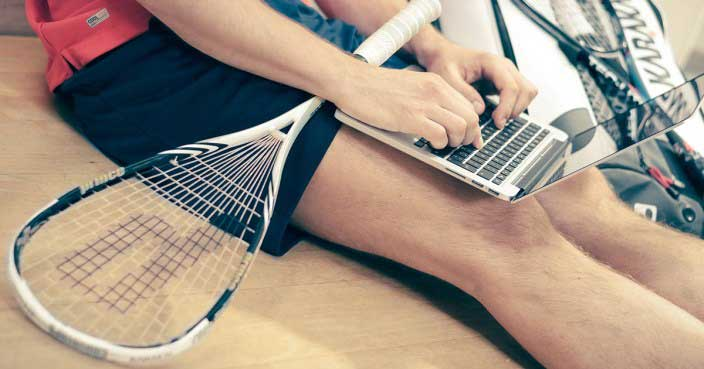 man with tennis racket shopping online ecommerce tips
