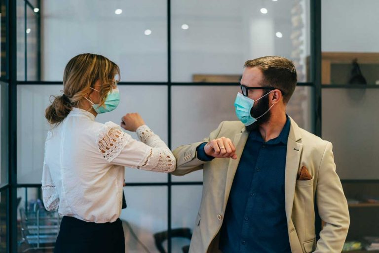 woman wearing mask using covid-19 health screening for employees