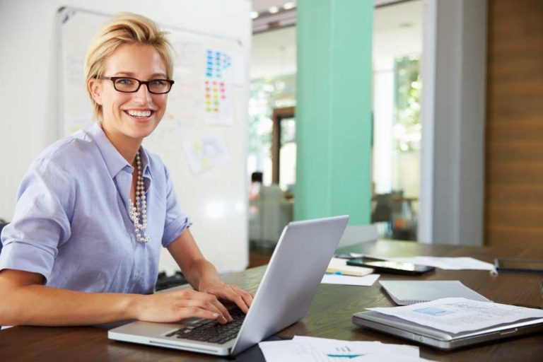 woman using hr help desk software on laptop
