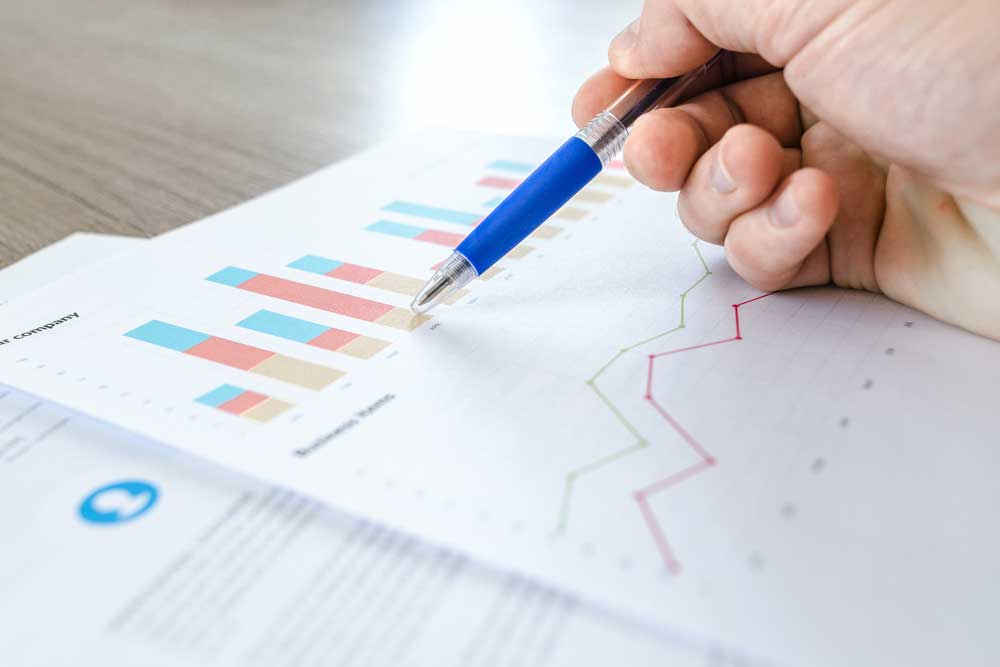 person reviewing charts to understand difference between correlation and causation