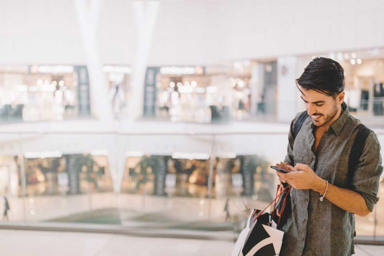 young man on mobile phone at a shopping center
