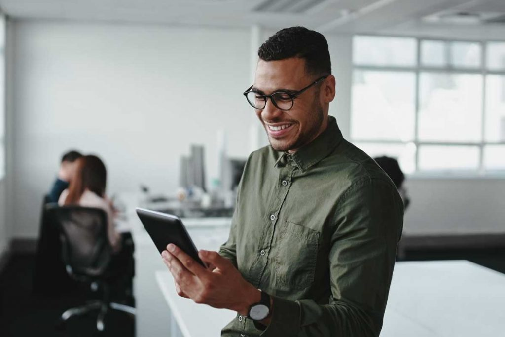man working in office customer experience team at a telecommunications brand